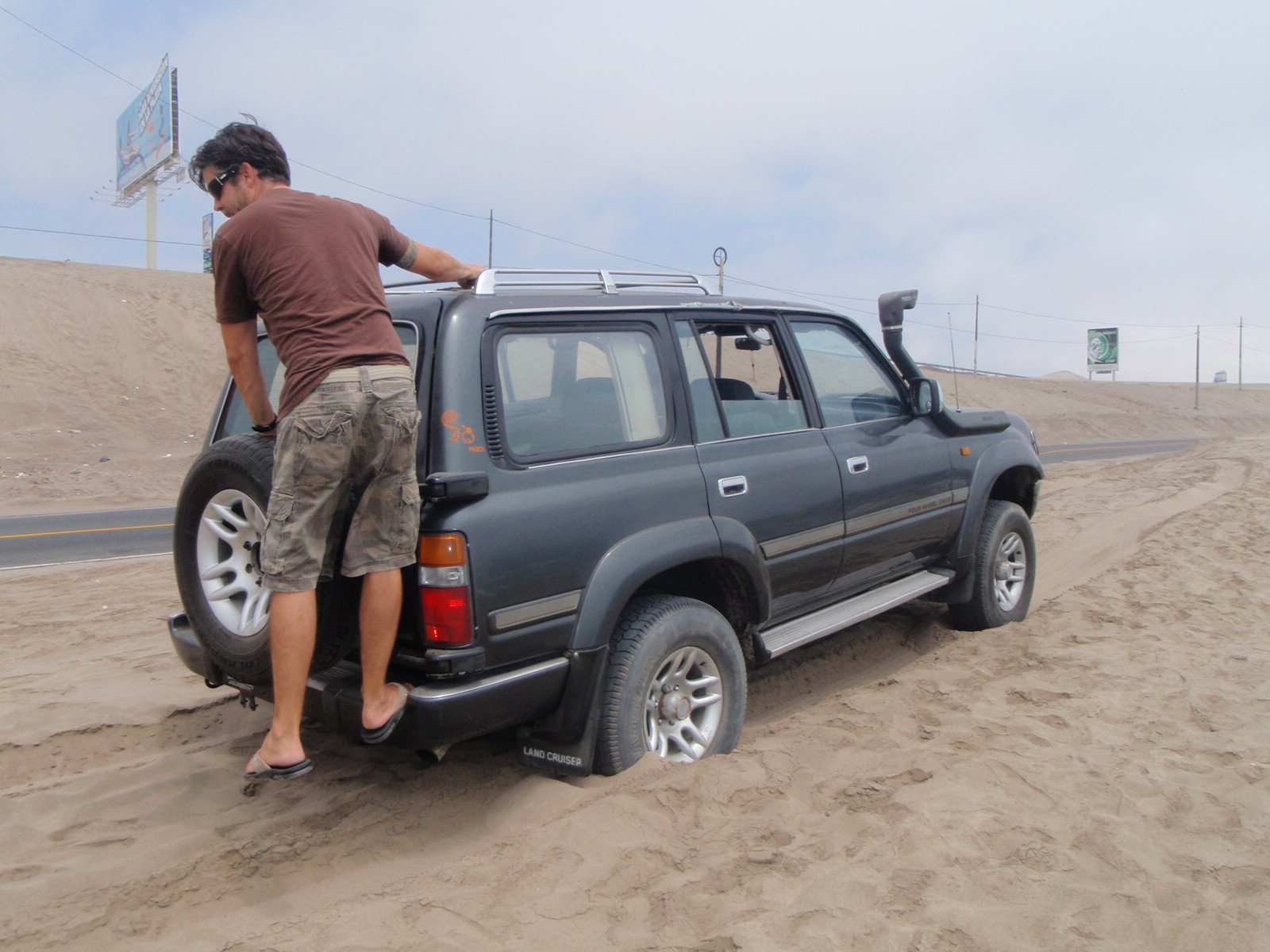 Stuck in the sand on the search for surf – with Jaime, somewhere south of Lima, Peru.