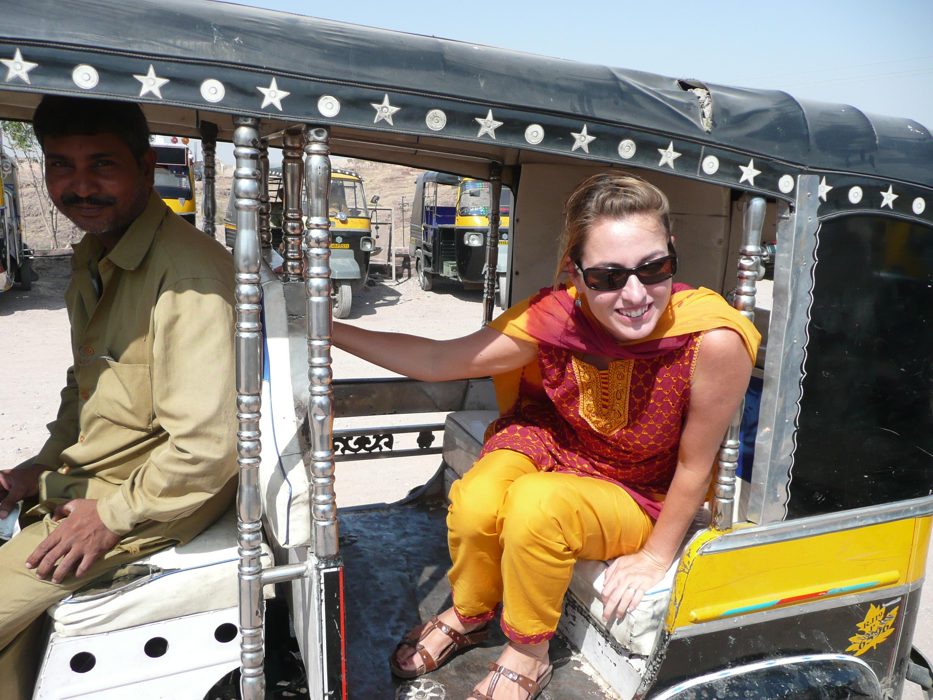Lila stepping out of a tuk tuk – Jodhpur, India